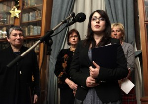 The daughter of fallen Russian oil oligarch Mikhail Khodorkovsky, Anastasia, speaks after receiving a literary prize, won by her father, while the writer Lyudmila Ulitskaya listens, during an awarding ceremony in Moscow